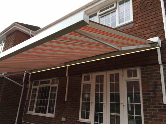 Patio Awning to tile hung house on bespoke brackets